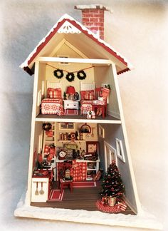 """The first in The Wonkies collection, the 1/4"""" scale Holly House is filled with Christmas cheer! This kit includes almost everything you need to make your own tiny crooked house! Kit includes: all of t"""