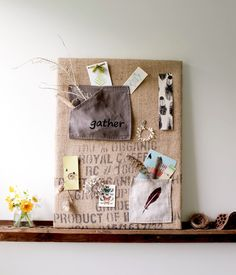 hessian-covered cork board - with or without pockets. Could use as wall art if the coffee sack graphics are pretty enough