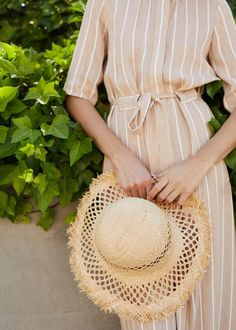 Essentials for your beach bag: A straw hat for sun safety.