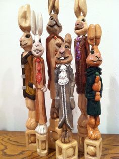 Easter bunnies hand carved with ball in cage carved by Chickanwhittle