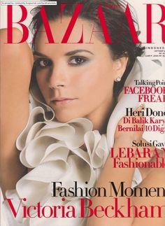 Victoria Beckham wearing a Peter Som for Bill Blass blouse.