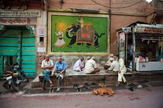 Steve McCurry, INDIA. Rajasthan, 2009. Circle of elderly men deep in conversation.