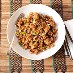 Sesame Pork Rice | Brightly flavored with garlic, ginger, soy sauce, and rice vinegar, this pork fried rice recipe is faster than take-out—ready in just 15...