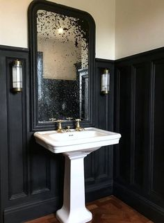 Monday Inspiration: Beautiful Rooms - Mad About The House - Love this aged antique mirror above the sink in the cloakroom with black wall panelling and parquet wooden flooring. Bad Inspiration, Bathroom Inspiration, Black Powder Room, Powder Rooms, Mad About The House, Downstairs Toilet, Bathroom Wall Lights, Bathroom Lighting, Wall Lighting