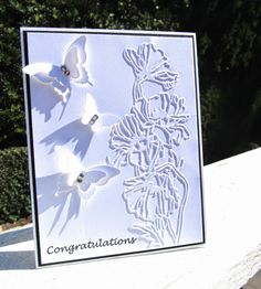 A Wedding Card using the Stampin' Up! butterfly punches along with some embossing. Details over at www.pinkblingcrafter.blogspot.com