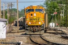 https://flic.kr/p/T8Ekvu | BNSF 9965 | EMD SD70MAC | BNSF Thayer South Subdivision | An empty coal train is snaked across three railroads in downtown Memphis. The front has just come onto BNSF track, the center on UP track and off into the distance the end can still be seen on NS track.