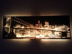 Take a black and white canvas photo, add 1 strand of white rope lights to the back and walah!