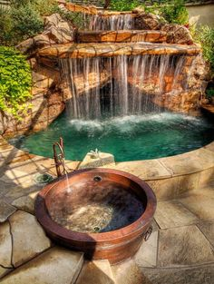 Backyard Oasis with a gorgeous waterfall pool. Who wouldn't love a waterfall pool of their own? I could live without the hot tub, but the waterfall pool. now that would be the life. Outdoor Spaces, Outdoor Living, Outdoor Tub, Outdoor Fountains, Outdoor Baths, Outdoor Bathrooms, Water Fountains, Garden Fountains, My Pool