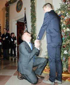"""This is US Marine Corps captain Matthew Phelps (on one knee), making history by becoming the first gay man to propose at the White House. He told Huffington Post:  """"I wanted to propose to [partner Ben Schock] at the White House because that's where we went for our first date, to the LGBT Pride Month Reception. Legalize that shit! (At the NATIONAL level)"""