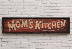 """Mom's Kitchen"" Wooden Sign - From Antiquefarmhouse.com - http://www.antiquefarmhouse.com/current-sale-events/kitchen6/moms-kitchen-sign.html"