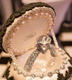 .That ring box is gorgeous--and the ring itself is breathtaking