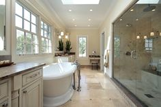 custom master bathroom pictures | Country inspired bathroom design with pedestal tub and large rainfall ...