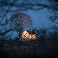 Our Webb Farmhouse glowing amidst the darkening Meadow Garden.  Photo by Duane Erdmann. #meadowgarden #farmhouse #longwoodchristmas #longwoodgardens #night #christmas #glow #wreath by longwoodgardens