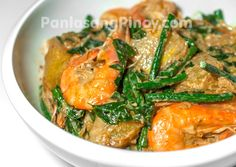 Ginataang Hipon, Sitaw, at Kalabasa is a delicious shrimp and vegetable dish that you should try. As the name connotes, ginataan refers to any dish cooked in coconut milk or coconut cream. This dish makes use of shrimps with shells and head on, string beans, squash, and malunggay leaves (moringa).