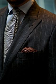 suitdup:    Well I don't think I see brown anywhere else but in the pocket square. That would mean that the brown is on an island but I doubt that's the case. Brown pants maybe? Maybe it's brown shoes or a brown belt but I am sure that brown is to match something.