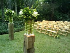 Love these Granny Smith Apples in these ceremony arrangements