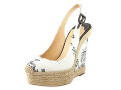 Toile closed toe sling-back wedge.