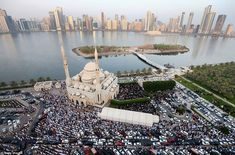 Muslims offer Eid al-Fitr prayers outside Al Noor Mosque on July 2015 in Sharjah, United Arab Emirates. The Muslim holiday Eid marks the end of 30 days of dawn-to-sunset fasting during the holy month of Ramadan. Eid Al Fitr, Islam Religion, Sharjah, United Arab Emirates, Amazing Architecture, Beautiful World, Ramadan, Birmingham, Places To See