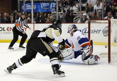 SEE YA NABOKOV !!! Sidney Crosby slides one right past the New York Islander goalie during Game 5 of the Eastern Conference Quarterfinals 5/9/13