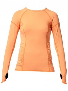 Roxy Outdoor Fitness Dawn Run Top   LoveSurf.com Superior breathability and a flattering fit—the Dawn Run-Running Shirt plays both sides of the performance coin. Designed for long runs when comfort and heat management are crucial, this performance longsleeve features zoned mesh inserts where women sweat the most and aptly placed seaming lines for abrasion-free comfort. The ultra-soft fabrication sweeps into subtle rouching at side hemlines for a slimming, feminine effect. #fitness #fashion…