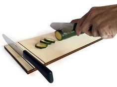 Anime is a laser cut wood chopping board and knife holder. It is hand natural finished and protected. It can accommodate two knives lying horizontally and can be used by... #tray