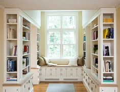 great reading nook with good light and good balance between open and closed storage.  Creative Home Library Designs For a Unique Atmosphere