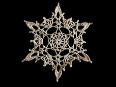 Free pattern: Crocheted Snowflake by Poodie