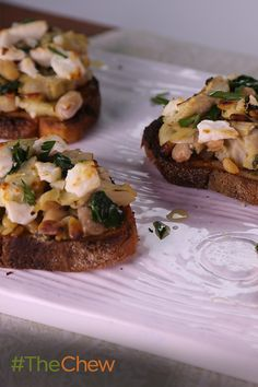 Need something fancy, easy and delicious to share with your guests? Look no further than Carla Hall's Artichoke & Feta Crostinis!