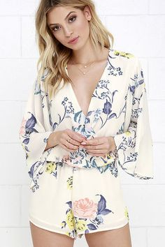 Happiness is all around whenever the Sing the Blooms Cream Floral Print Romper makes an appearance! Lightweight, cream Georgette with a yellow, blue, and blush floral print covers a surplice bodice (with modesty snap) and wide three-quarter sleeves. Elasticized waist leads into attached shorts.