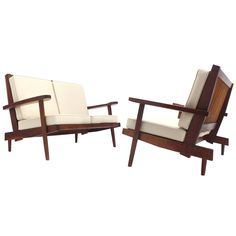 Pair of George Nakashima Walnut Settees with Arms | See more antique and modern Sofas at https://www.1stdibs.com/furniture/seating/sofas