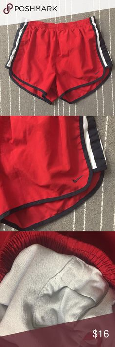 Nike Dri Fit red black women running shorts. Nike Dri Fit red black women running shorts. It's in great condition. Size is Small true to size. Include a key pocket inside. Nike Shorts