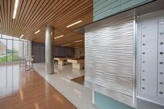 Wall panel and column in Stainless Steel with Sandstone finish and Kalahari Impression pattern at Salem State University, Salem, Massachusetts