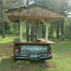 Use an old bed truck for an outdoor bar/eating area