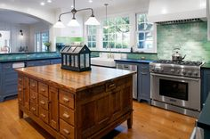 Farmhouse Kitchen by JWT Associates (antique school science lab table for an island)