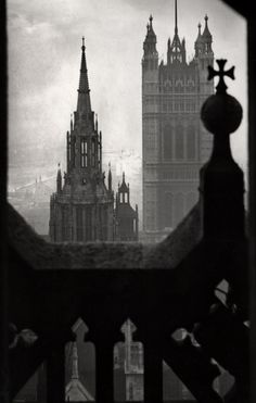"Keep seeing this incorrectly labelled: should be ""The Houses of Parliament, from [the] Clock Tower, 1934"", by E. O. Hoppé (not from Victoria Tower). That spire in the foreground is the 'Central Tower', Victoria Tower is behind it (former storage place for Parliamentary records), which is why it can't be 'from it'. The Clock Tower/Elizabeth Tower (the one with Big Ben in) overlooks the other two. These windows are just above the clock faces.  No biggie!"