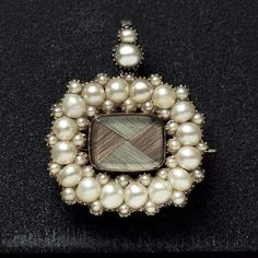 Woven hair brooch with a pearl halo. Georgian Pearl Mourning Pendant Brooch.