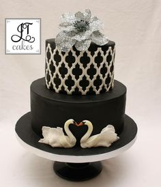 Black cake with white lattice & two swans