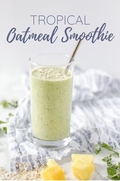 This delicious tropical oatmeal smoothie is the perfect way to start your morning. Bananas, mangos, and pineapple come together with coconut milk, oats, and greens to make a healthy, veggie- and fruit-packed smoothie. #ablossominglife #oatmealsmoothie #smoothie #smoothierecipe