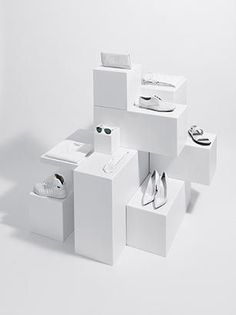 White boxes layered to create an interesting display.