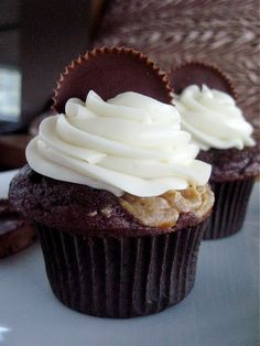peanut butter filled chocolate cupcakes with cream cheese buttercream frosting