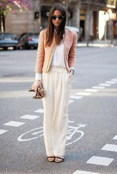 Pink pastel coat and cream wide pants.