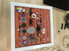Our earring and ringholder - made with IKEA picture frame, foam and some nice fabric