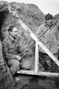 1ST BATTALION CAMERONIANS SCOTTISH RIFLES WESTERN FRONT 1914 - 1915 (Q 51587)   2nd Lieutenant L J Barley of the 1st Battalion, Cameronians (Scottish Rifles), watching as a rifle grenade is prepared for firing from trenches at Grande Flamengrie Farm on the Bois Grenier sector of the line during February 1915.
