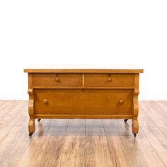 This dresser is featured in a solid wood with a glossy maple finish. This American traditional style chest of drawers has 3 spacious drawers, castor wheels, curved trim, and dovetailed joinery. Perfect for storing clothing! #americantraditional #dressers #shortdresser #sandiegovintage #vintagefurniture