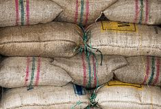 Stock photo of Stack of bags of coffee beans. by MikeMarlowe Coffee Images, Coffee Beans, Burlap, Reusable Tote Bags, Stuff To Buy, Green, Hessian Fabric, Coffee Pictures, Jute