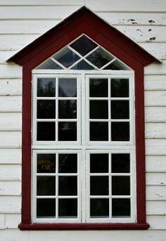 Rococo window of Sagfjord church, built in 1885, Norway