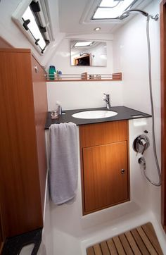 All-in-One Shower Space. Love this idea...with a sunken jacuzzi tub underneath an easy-open floor. :-) #NewRules