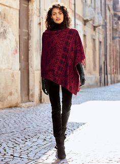 Romantic roses reverse to fine-scale geometrics in rich tones of carmine and black. The poncho is a layer of weightless warmth in a double-face knit of pima (52%), baby alpaca (34%) and nylon (14%). An elegant outerwear option, the rectangular shape can be worn as a boatneck or rotated to wear as a v-neck.