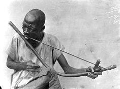 Obu man playing a musical bow Obubra, Cross River State, Nigeria, ca. 1909-1913
