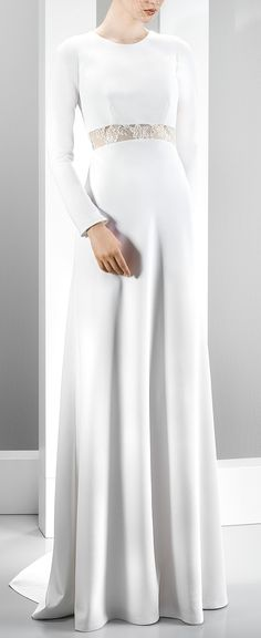 Sophisticated and understated long sleeve wedding dress.